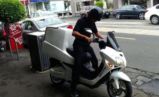 Man On Electric Motorbike With Cargo Box
